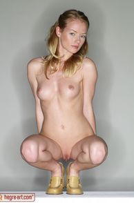 Erotic Woman With Small Breasts Squatting
